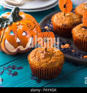 Pumpkin muffins with chocolate chips for Halloween kids party. Holiday decorations - Stock Photo