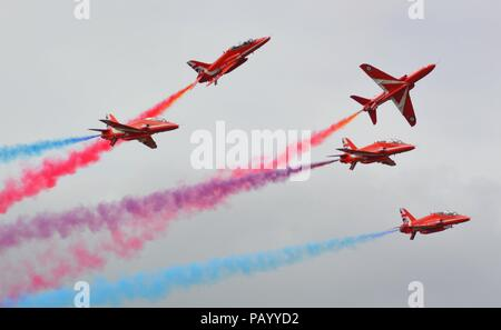 RAF Red Arrows performing at the Royal International Air Tattoo 2015 in Fairford, UK - Stock Photo