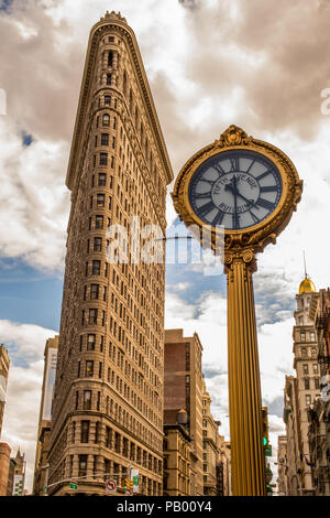 The Golden Clock and the Flat Iron Building, New York City, USA - Stock Photo