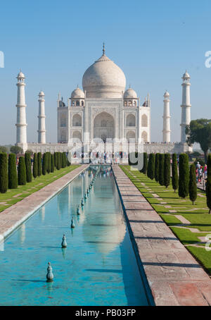Taj Mahal early morning with reflection in water - Stock Photo
