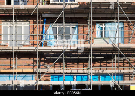 scaffolding at a residential building currently under construction - Stock Photo