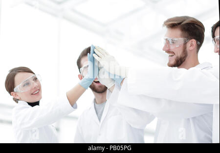 scientists giving each other a high five - Stock Photo