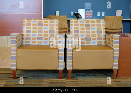 Two empty arm chair sofas in the waiting area of Scott & White Hospital in College Station, Texas, United States. - Stock Photo