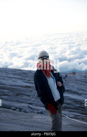 Smiling Woman hiking in mountains, Kota Kinabalu, Borneo, Malaysia - Stock Photo