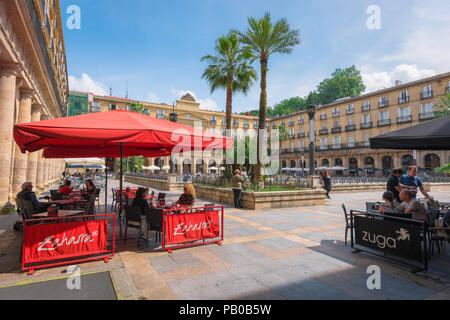 Bilbao Plaza Nueva, view of people seated at cafe terraces in the Plaza Nueva in the Old Town (Casco Vieja) area of Bilbao, Spain. - Stock Photo