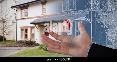 Composite image of copped hand on businessman holding invisible product - Stock Photo