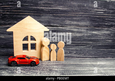 family, wooden house model and car. buying and selling or car insurance. business success. concept of real estate, buying, renting or selling housing - Stock Photo