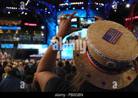 A woman records the invocation at the Democratic National Convention, Charlotte, North Carolina, September 4, 2012. - Stock Photo