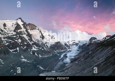 View from Kaiser Franz Josefs Höhe on Pasterze, morning mood, Grossglockner, behind Johannisberg, Hohe Tauern National Park - Stock Photo