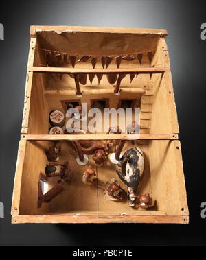 Model of a Slaughter House. Dimensions: L. 76.8 cm (30 1/4 in.); W. 58.5 cm (23 1/16 in.); greatest H. 58.5 cm (23 1/16 in.). Dynasty: Dynasty 12. Reign: early reign of Amenemhat I. Date: ca. 1981-1975 B.C..  This model of a meat processing installation was found with twenty three other models of boats, gardens, and workshops in a hidden chamber at the side of the passage leading into the rock cut tomb of the royal chief steward Meketre, who began his career under King Nebhepetre Mentuhotep II of Dynasty 11 and continued to serve successive kings into the early years of Dynasty 12.  Two oxen a - Stock Photo