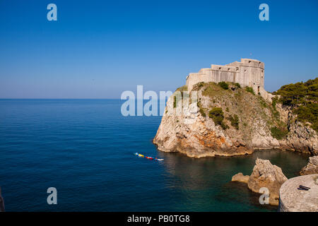 A fortification jutting out into the sea, seen from the city of Dubrovnik in the Croatian Adriatic Sea. - Stock Photo