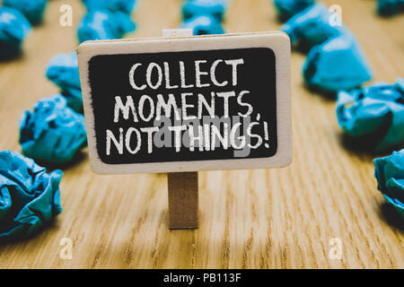 Handwriting text writing Collect Moments, Not Things. Concept meaning Happiness philosophy enjoy simple life facts Stand blackboard with white words b - Stock Photo