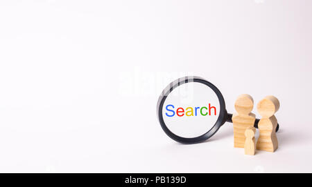 Wooden figures of people stand near the magnifying glass. The family is looking for something. Search service. Find on the Internet. Social networks.  - Stock Photo