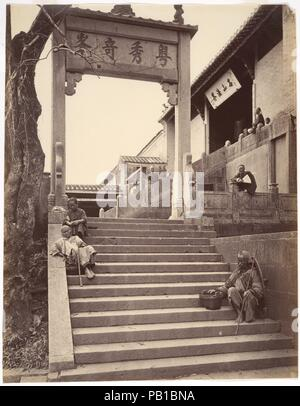 Beggars at the Gate of a Temple, Canton. Artist: Attributed to John Thomson (British, Edinburgh, Scotland 1837-1921 London). Dimensions: Image: 27.3 x 21.3 cm (10 3/4 x 8 3/8 in.). Date: ca. 1869.  From 1868 to 1872, Thomson assembled his masterful documentation of China, published after he returned to Britain as Foochow and the River Min (1873) and the four-volume Illustrations of China and Its People (1873-74).  Thomson's extensive travels took him throughout the Foochow region, on a three-thousand mile journey along the Yangzi, and to the western plains of Taiwan and the southern port citie - Stock Photo
