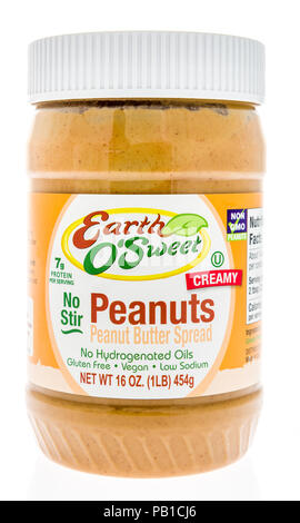 Winneconne, WI - 21 July 2018 -  A jar of Earth O' Sweet peanut butter on an isolated background. - Stock Photo