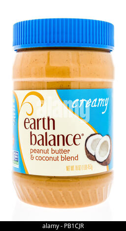 Winneconne, WI - 21 July 2018 -  A jar of Earth Balance peanut butter and coconut blend on an isolated background. - Stock Photo