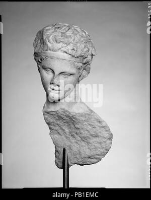 Head and part of the back of a marble statue. Culture: Roman. Dimensions: H. 17 1/4 (43.8 cm.)  width 8 1/4 (21.0)  depth  8 1/2 (21.6 cm.). Date: 1st or 2nd century A.D..  Copy of a Greek statue of the 4th century B.C.  The young satyr, identifiable by his pointed animal ears, was shown pouring wine. Many Roman copies of this appealing work are known today. Museum: Metropolitan Museum of Art, New York, USA. - Stock Photo