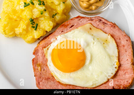a typical bavarian snack the leberkaese with potato salad - Stock Photo