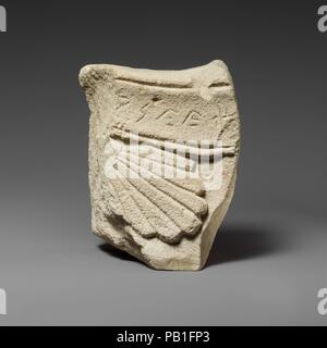 Limestone inscribed relief fragment. Culture: Cypriot. Dimensions: Overall: 4 1/4 x 5 5/8 x 2 1/4 in. (10.8 x 14.3 x 5.7 cm).  Grave releif fragment with palmette and inscription. Museum: Metropolitan Museum of Art, New York, USA. - Stock Photo