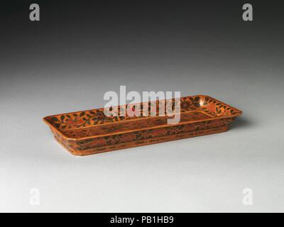 Rectangular tray with double dragons. Culture: China. Dimensions: H. 1 1/2 in. (3/8 cm); W. 6 1/8 in. (15.6 cm); L. 14 5/8 in. (37.1 cm). Museum: Metropolitan Museum of Art, New York, USA. - Stock Photo