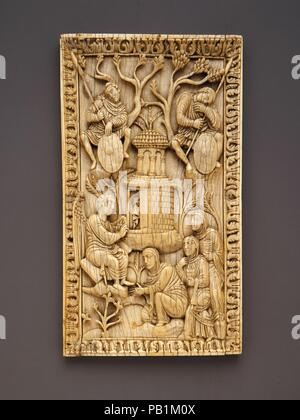 Plaque with the Holy Women at the Sepulchre. Culture: North Italian. Dimensions: Overall: 7 1/2 x 4 1/4 x 5/16 in. (19 x 10.8 x 0.8 cm). Date: early 10th century.  This ivory plaque probably once served as part of a decorative cover for a liturgical manuscript. Three holy women intent on anointing the body of Jesus approach his burial place, the Holy Sepulchre, seen here as a twostory cylindrical building. A man 'robed in white,' and endowed here with wings, informs them that Jesus has risen from the dead. The Roman soldiers are asleep at their posts, completely unaware of the miracle of the R - Stock Photo