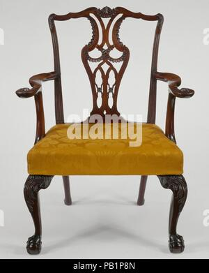 Armchair. Culture: American. Dimensions: 39 1/2 x 30 x 23 1/2 in. (100.3 x 76.2 x 59.7 cm). Date: 1770-90.  Like much New York furniture, this armchair follows English precedents in having a low back and tapering rear legs that end in oval spade feet. It descended in the family of Samuel and Judith Verplanck, whose complete parlor furnishings are displayed in the Verplanck Room (gallery 718). Museum: Metropolitan Museum of Art, New York, USA. - Stock Photo