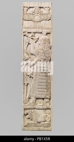 Furniture plaque carved in relief with warrior holding lotuses. Culture: Assyrian. Dimensions: 11.38 x 2.72 x 0.2 in. (28.91 x 6.91 x 0.51 cm). Date: ca. 8th century B.C..  This ivory panel was found in a storage room in Fort Shalmaneser, a royal building at Nimrud that was used to store booty and tribute collected by the Assyrians while on military campaign. Like many other panels from the same storage room, it was part of a chair or couch back or the headboard of a bed. Twenty pieces of furniture were discovered stacked in orderly rows in this room, where they had been stored before the dest - Stock Photo