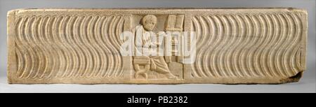 Sarcophagus with a Greek Physician. Culture: Roman. Dimensions: 21 3/4 x 23 1/4 x 84 7/8 in.  (55.2 x 59.1 x 215.6 cm). Date: early 300s.  The tomb's owner is shown seated with an open scroll, the pose of a philosopher, demonstrating that he is a learned man. His profession can be identified by the open case containing surgical tools on the cabinet top. Other scrolls and a basin for bleeding patients within the cabinet offer further proof of his profession. The style of his dress and the language of the inscription indicate that he was one of the many Greeks living in Italy. Beginning in the 3 - Stock Photo