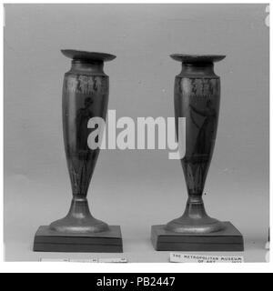 Pair of candlesticks. Culture: French. Dimensions: Height (each): 7 1/4 in. (18.4 cm). Date: late 18th-early 19th century. Museum: Metropolitan Museum of Art, New York, USA. - Stock Photo