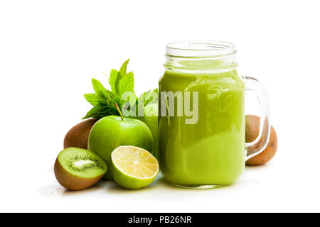 Fresh  smoothie with green fruits in a glass jar mug isolated on white - Stock Photo