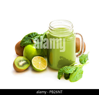 Fresh  smoothie with green fruits and spinach in a glass jar mug isolated on white - Stock Photo