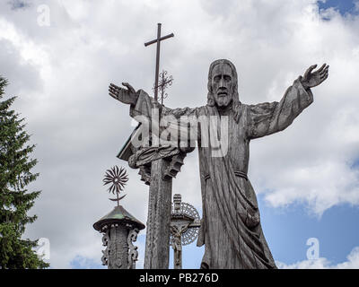 Wooden Jesus Christ figure on the Hill of Crosses, Lithuania - Stock Photo