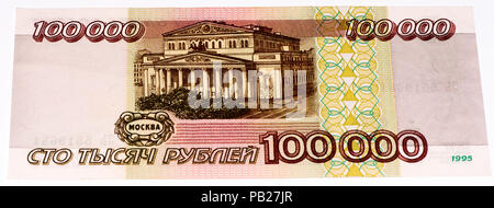 VELIKIE LUKI, RUSSIA - JULY 30, 2015: 100000 Russian ruble former bank note before 1997. RUble is the national currency of Russia - Stock Photo