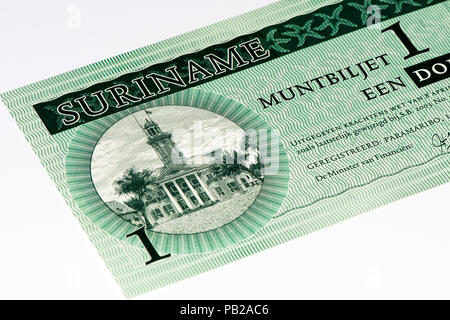 1 Surinamese dollar bank note. Surinamese dollar is the national currency of Suriname - Stock Photo