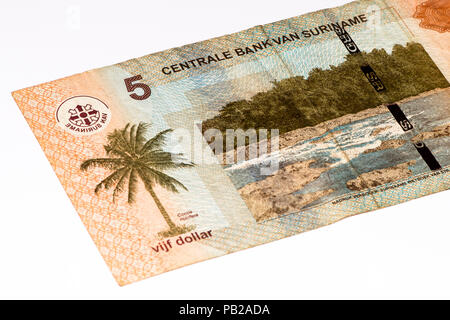 5 Surinamese dollar bank note. Surinamese dollar is the national currency of Suriname - Stock Photo