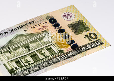 10 Surinamese dollar bank note. Surinamese dollar is the national currency of Suriname - Stock Photo