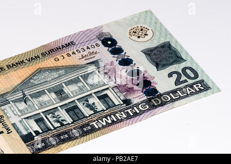 20 Surinamese dollar bank note. Surinamese dollar is the national currency of Suriname - Stock Photo