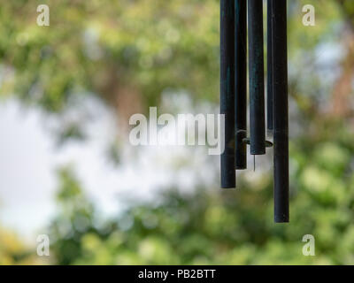 brass hanging wind chimes Stock Photo: 235212777 - Alamy