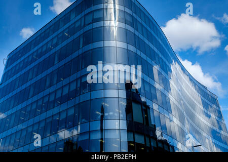 Old buildings reflected in a new glass fronted building in Queen Street, Glasgow, Scotland - Stock Photo