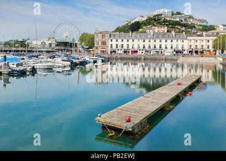 21 May 2018: Torquay, Devon, England, UK - The marina, harbour and town on a sunny spring day. - Stock Photo