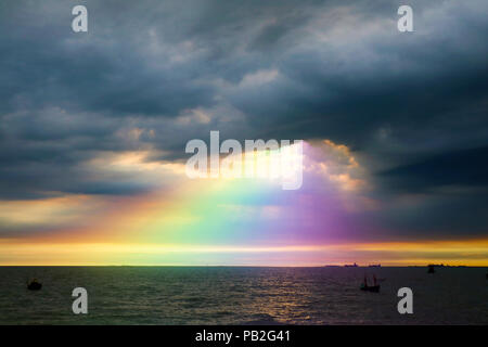 rainbow back dark cloud on sea. concept god bless, luck, wish, gift, lucky, - Stock Photo