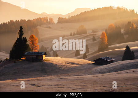 Misty landscape view in Alpe di Siusi or Seiser Alm at beautiful sunrise, Dolomites mountain, Italy - Stock Photo
