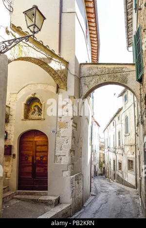 Amelia, Umbria. Pretty Italian village. Characteristic alley with a sacred image of the Virgin Mary - Stock Photo