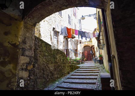 Pretty Italian village. Characteristic alley with hanging clothes - Stock Photo