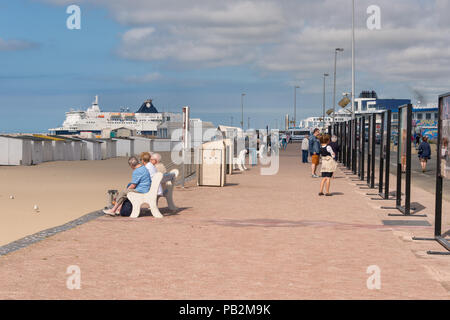Calais, France - 19 June 2018: People walking along the seafront in the summertime - Stock Photo