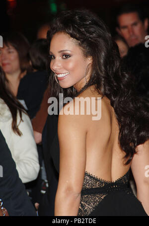 Alicia Keys arriving at the Smokin' Aces at the Chinese Theatre In Los Angeles. January 18, 2007.  smile portrait headshot back of the shoulderKeysAlicia032 Red Carpet Event, Vertical, USA, Film Industry, Celebrities,  Photography, Bestof, Arts Culture and Entertainment, Topix Celebrities fashion /  Vertical, Best of, Event in Hollywood Life - California,  Red Carpet and backstage, USA, Film Industry, Celebrities,  movie celebrities, TV celebrities, Music celebrities, Photography, Bestof, Arts Culture and Entertainment,  Topix, vertical, one person,, from the years , 2006 to 2009, inquiry tsun - Stock Photo