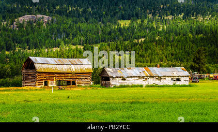 Old barn build from logs in a farmers field along the Coldwater Road between Hope and Merriit in beautiful British Columbia, Canada - Stock Photo