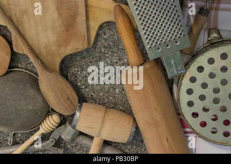 Rural kitchen utensils on vintage planked wood table from above - rustic background with free text space Free space in the shape of a heart. - Stock Photo