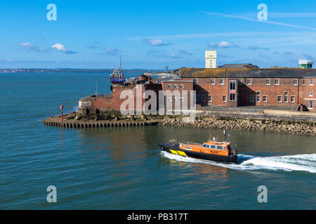 An Associated British Ports pilot vessel heading out of Portsmouth Harbour past Fort Blockhouse England - Stock Photo