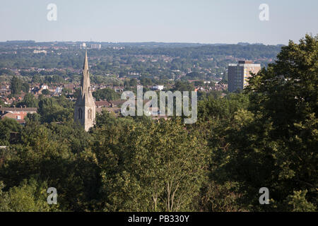 The rooftops of Sydenham houses and in the distance, the tall buildings of London Docklands, on 23rd July 2018, in London, England. - Stock Photo